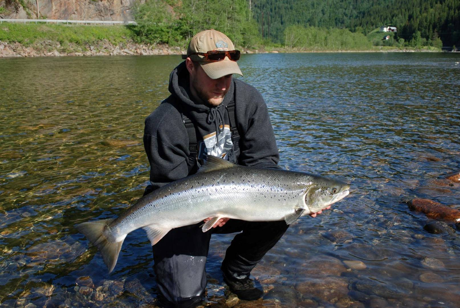 Daniel Persson with his first salmon of his week