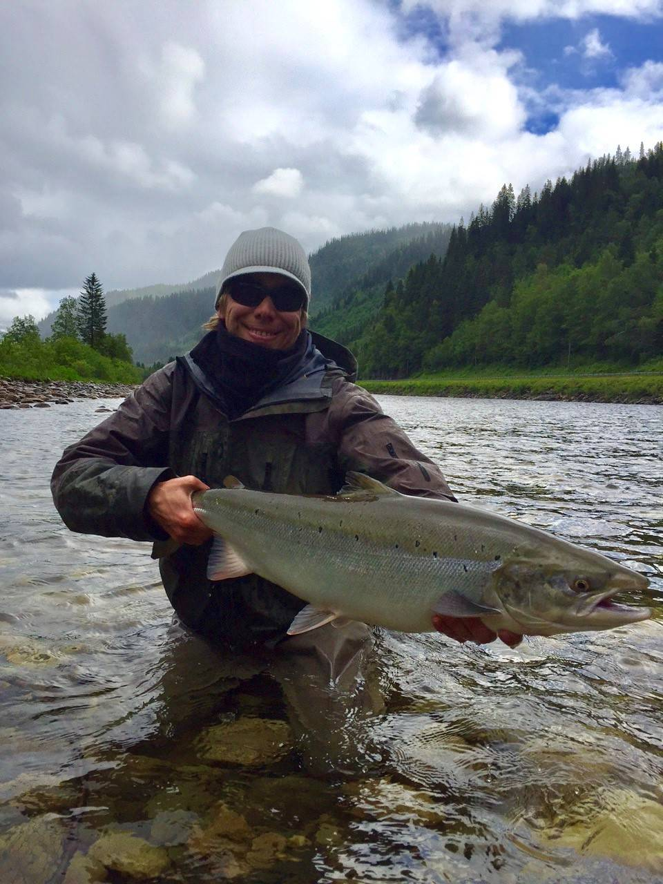 Thies smiles while holding his beautiful salmon from Beat BS1.