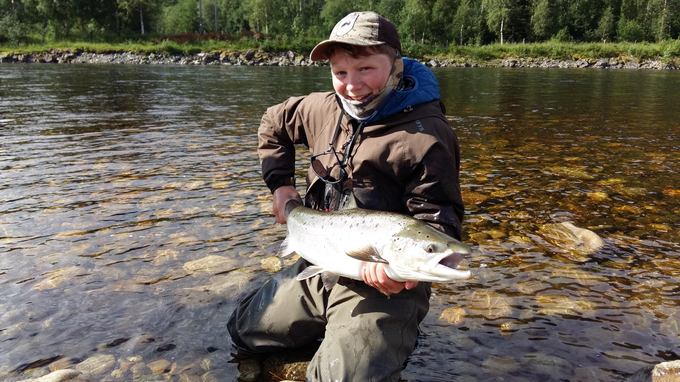 Blaine Lyon (13 years old) with his fish from New Pool